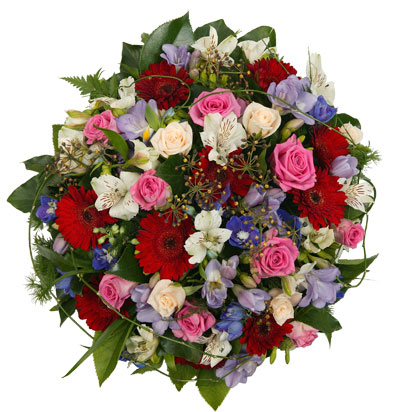 This striking round table arrangement is the perfect centre piece for any dinner party