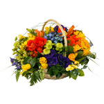A beautiful vibrant basket of striking colours in a modern design for any occasion