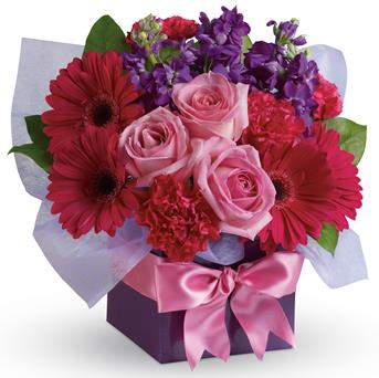 - A stunning study in contrasts, this fabulously feminine arrangement mixes pale pink roses with hot pink gerberas and purple st