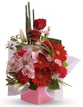 - The art of love. Take their breath away with this uniquely sculptural arrangement of lilies, gerberas and canes of bamboo-like