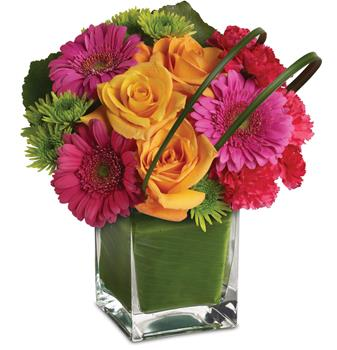 It's party time! And this ravishingly radiant array of orange roses and hot pink favourites presented in a leaf lined vase, is r