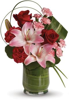 This gorgeous arrangement delivers the spirit of adventure. It's a unique mix of red roses, pink lilies, leaves and lily grass a