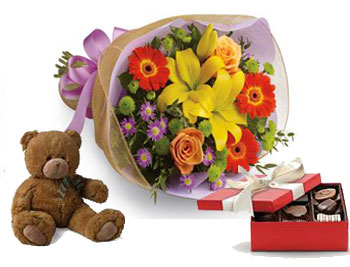 A burst of brilliant flowers designed to make their spirits soar! with choc & teddy