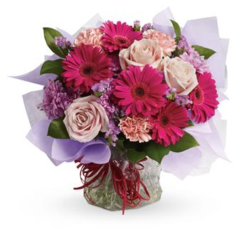 - Treat them to a special surprise! Hot pink gerbera mix with pale pink roses and carnations in this delightfully delicious bouq
