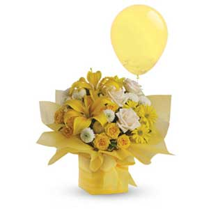 This sunny array of flowers in a decorative mini box makes a tantalizing gift for someone with taste.