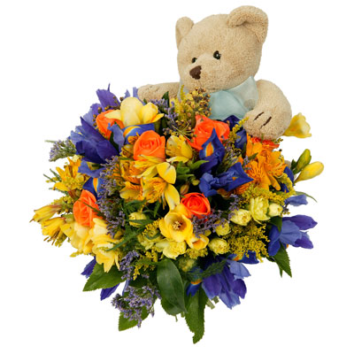 A fun spring bouquet with cuddly soft toy. Vase not included