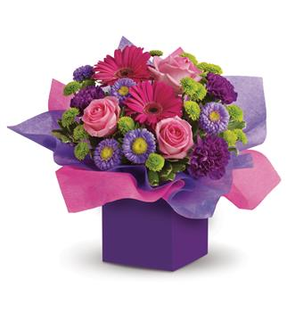 - If someone you know loves the colours pink and purple,this box arrangement will create a sensation! A flower arrangement desig