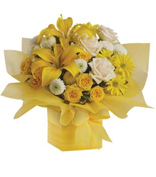 - As refreshing as lemon sherbet, this sunny array of flowers in a yellow gift box tied with a matching ribbon makes a perfect g