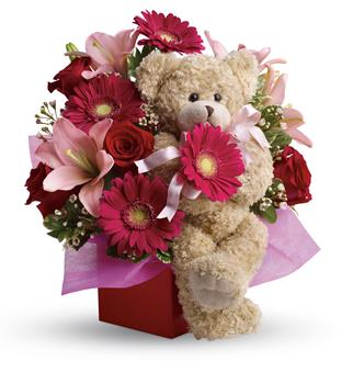 - Send a smile and a hug with this stylish mixed arrangement of hot pinks and reds accented with a snuggly bear that everyone wi