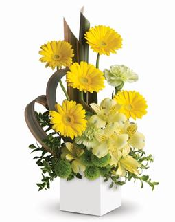 - Send smiles across the miles. This artful arrangement of sunny yellow blooms in a modern pot is specially designed to warm hea