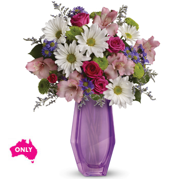 A great way to make someone smile - a delightful mix arranged in a lavender Beauty vase