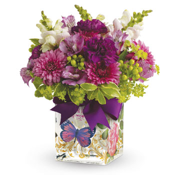Lift a good friend's spirits with a lovely lavender and green arrangement, and send cheerful wishes their way! Presented in a En