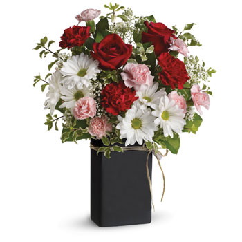 Send this romantic array of gorgeous red roses and other favourites in a ceramic Chalk it keepsake vase, that's actually a chalk