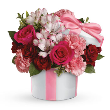 Tickle her pink with this sweetly chic mix. Arranged in a Hats Off keepsake vase, this arrangement blends hot pink and deep crim