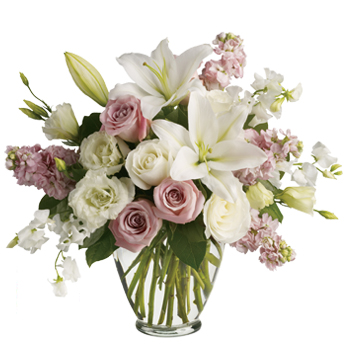 Natural vase arrangement of roses, lilies, and lissies