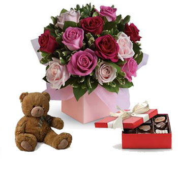 Sing her a love song - with roses chocolates and a teddy