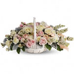 These serene, softly coloured roses and chrysanthemums are a heartfelt way to offer comfort and consolation.