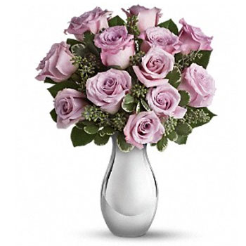 Presenting one dozen luscious lavender roses artistically arranged – the effect is nothing short of breathtaking. Imagine