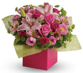 "Any time is the perfect time to send a ""pink-me-up"" with this lush arrangement of lilies, roses and asters!"