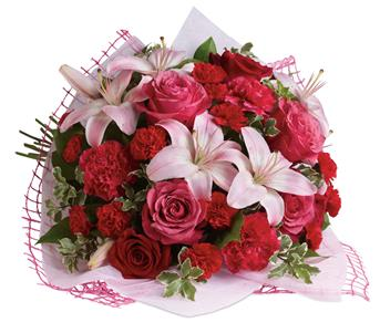 Give a bouquet that will completely capture her heart. A classic gift of roses and lilies that will truly delight!