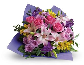 Contemporary yet classic, this bouquet includes an elegant mix of roses, lilies and alstroemeria.