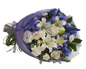 Capture the magic of twilight with this enchanting array of luxurious lilies, roses and iris.