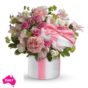 This blushing arrangement gathers beautiful blooms,arranged in a ceramic hat box