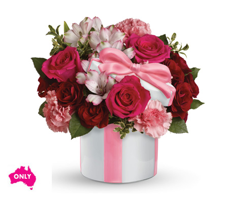 A sweet chic mix arranged in a ceramic hat box