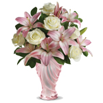 A spectacular choice of flowers arranged in our Love glass vase