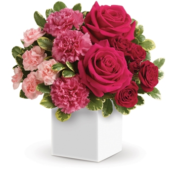 Celebrate someone special with this sweet, modern style box arrangement of hot pink and red roses and pale pink carnations. It's