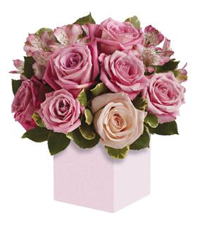 Exquisite rose box arrangement featuring soft, romantic shades of pink.