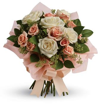 A fresh, feminine spin on the classic rose bouquet, this creamy mix of peach and cream roses is the ultimate in romance.