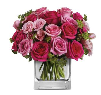 This exquisite arrangement of light pink and hot pink roses, is a gift that will long be remembered.