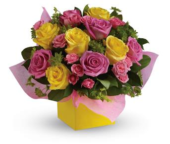 This stunning arrangement of pink and yellow roses adds an instant smile to anyone's face.