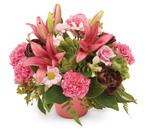 - Modern arrangement of lilies, chrysanthemums and carnations add a touch of something different.
