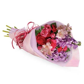 Someone you know will jump for joy when they receive this charming bouquet. Soft feminine colours wrapped in a pretty package
