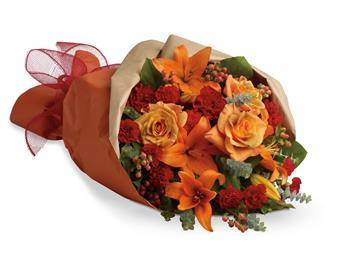 Beautiful and breathtaking as a sunset. This bouquet contains lilies, roses and mini carnations.