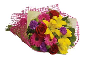 Let the sun shine in with this exuberant bouquet of golden lilies, rich red roses and hot pink gerberas.