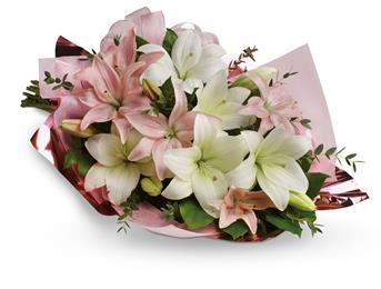 Stunning in its simplicity, an innocent harmony of light pink roses and snow white lilies.