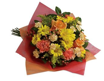 Tickle their fancy with this playful mix of yellow daisies, pink carnations and peach roses.