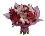 This stylish array of roses, lilies and gerberas makes yours a sophisticated statement of affection.