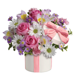 Make her day with this charming arrangement in a charming ceramic hat box.She'll adore it