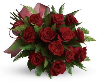 A lavish tribute to your one true love, this decadent dozen is accented with pretty ribbon and delicate greenery.