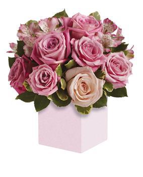Exquisite rose box arrangement featuring soft, romantic shades of pink.