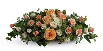 Set the scene for romance with this lavish table arrangement of peach, pink and cream roses. Beautiful on an entry table, too!